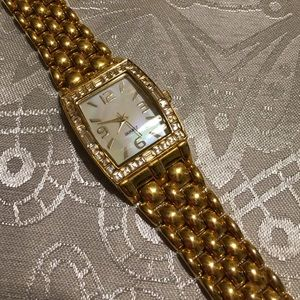 Avon Mother of Pearl and baguette crystal watch